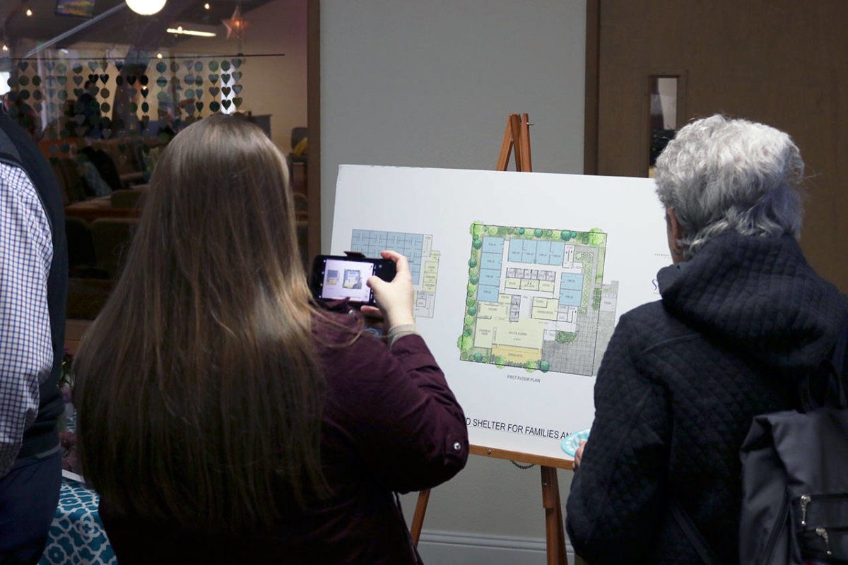 Community members join local government leaders, church officials and workers at the Salt House Church in Kirkland to celebrate the shelter groundbreaking. Locals were able to see designs for the shelter and ask questions of staff. Kailan Manandic/staff photo