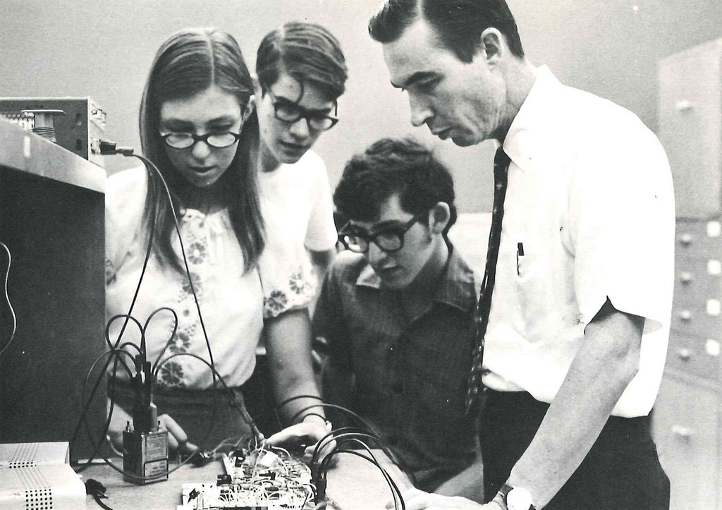 Patricia Tressel (BS '74) examines circuitry with Carver Mead (BS '56, MS '57, PhD '60), the Gordon and Betty Moore Professor of Engineering and Applied Science, Emeritus