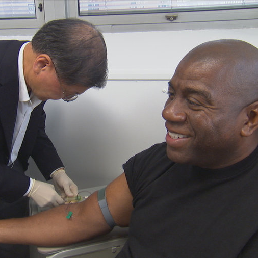Ho treating one of his most famous patients, Magic Johnson. Based on his research, Ho championed a combination antiretroviral therapy, which has dramatically increased the lifespan of millions infected by HIV.