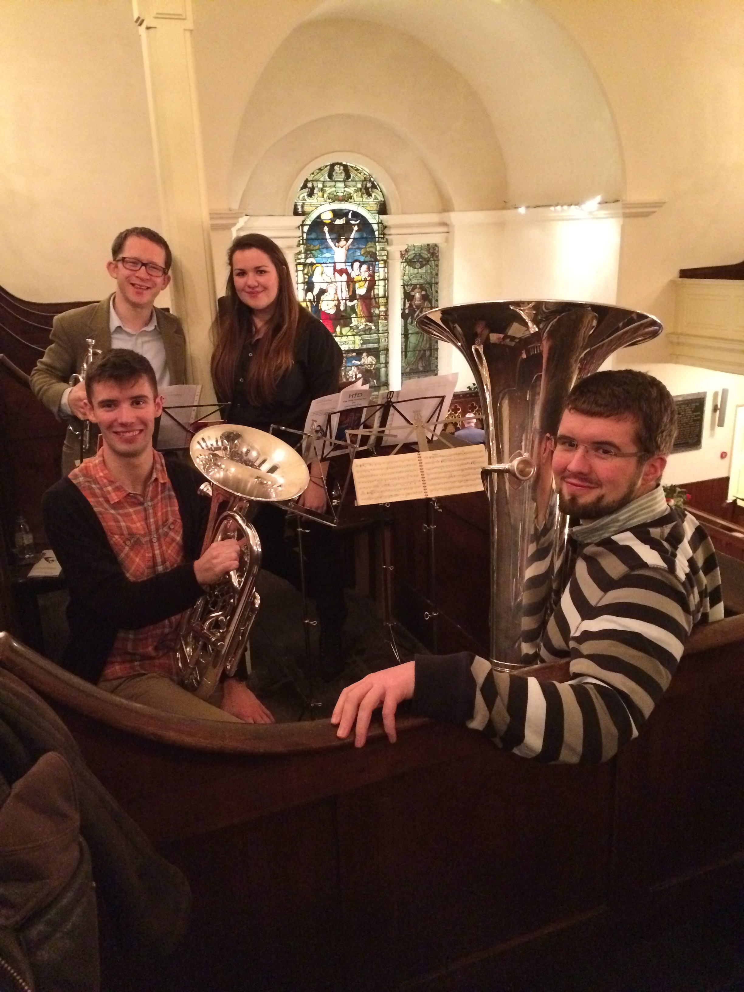 A brass quartet from church and village performing at the Christmas Midnight Eucharist