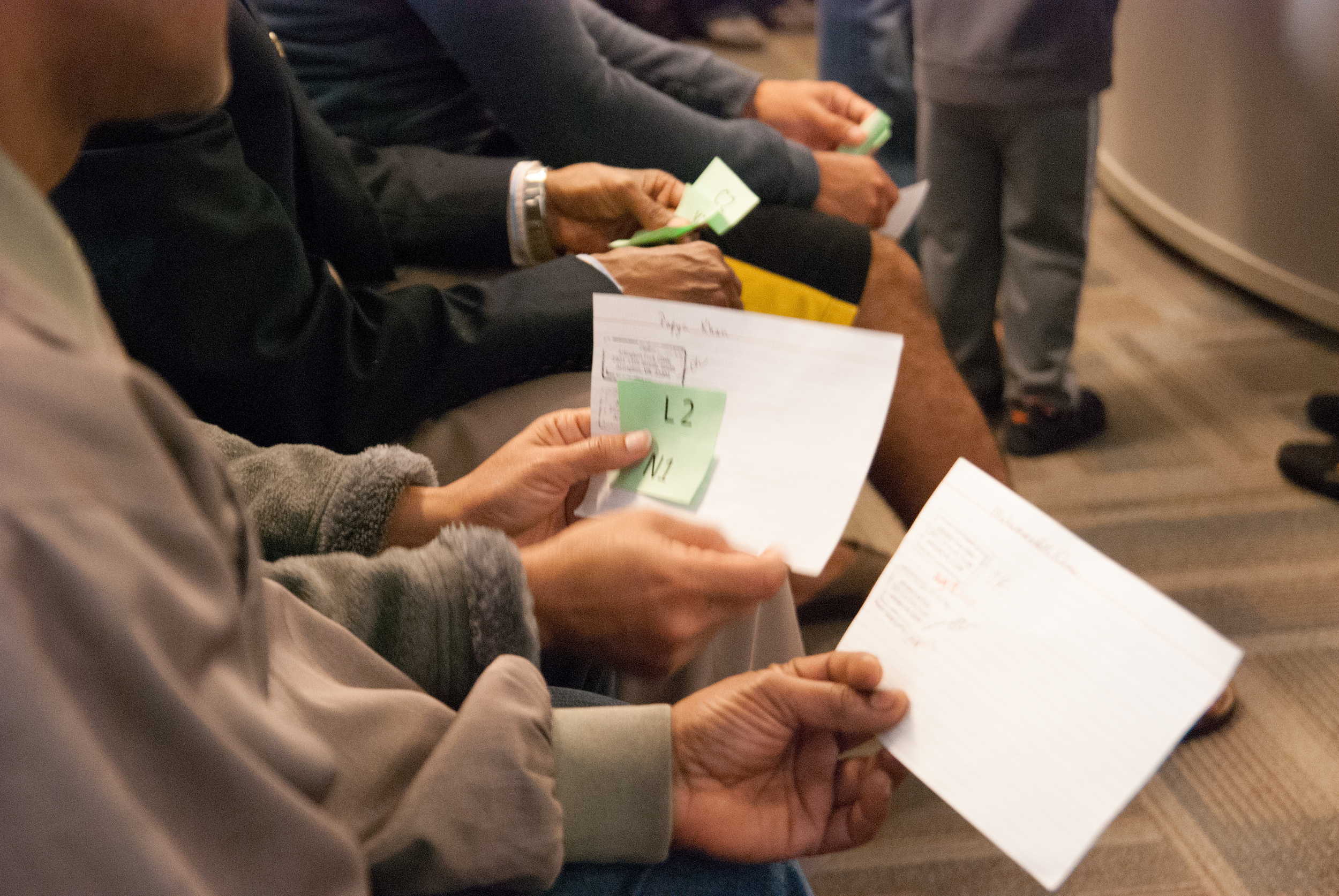 Lottery hopefuls wait for their numbers to be called.