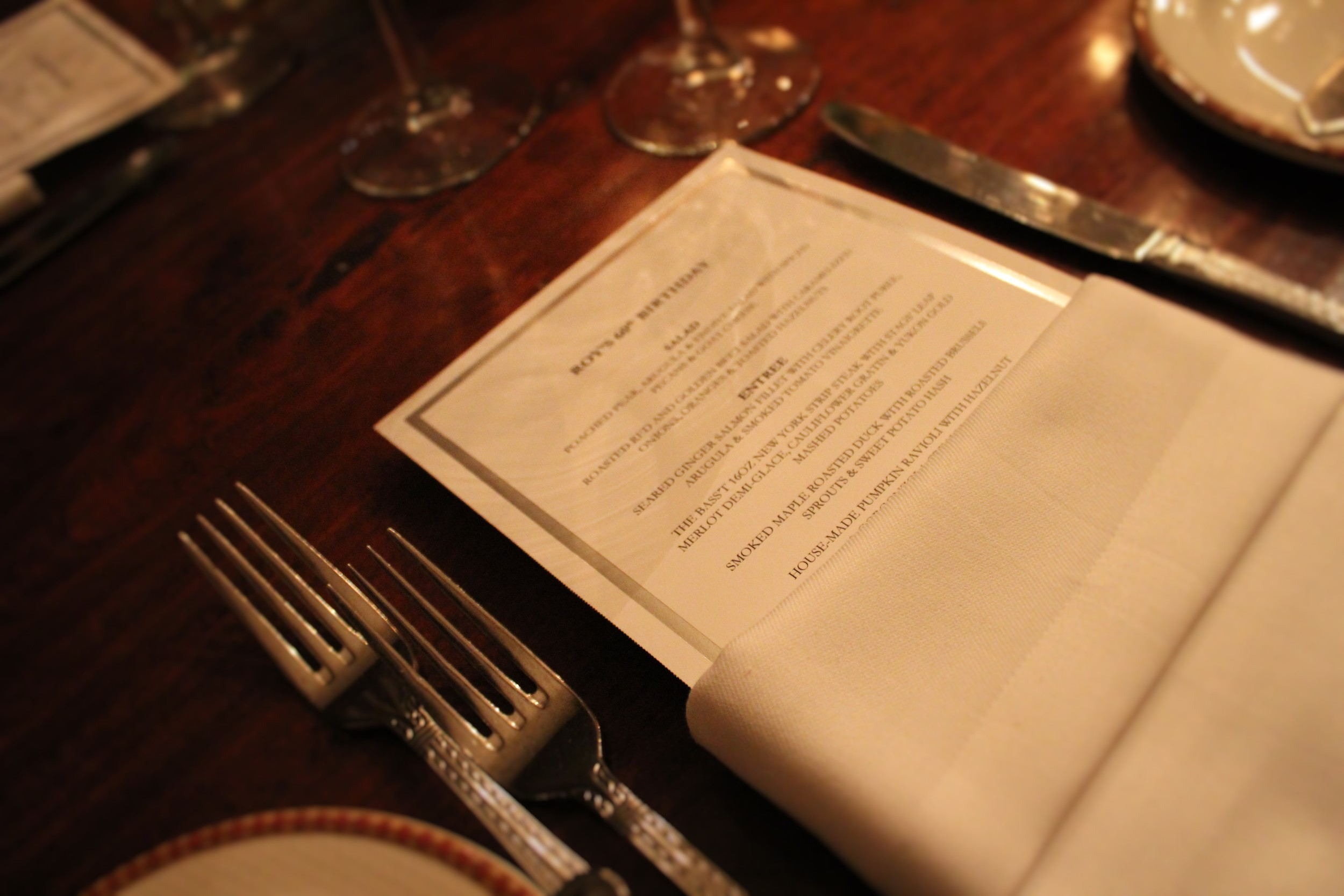 Menus were custom designed and printed in-house on silver-foiled paper from  LCI  .