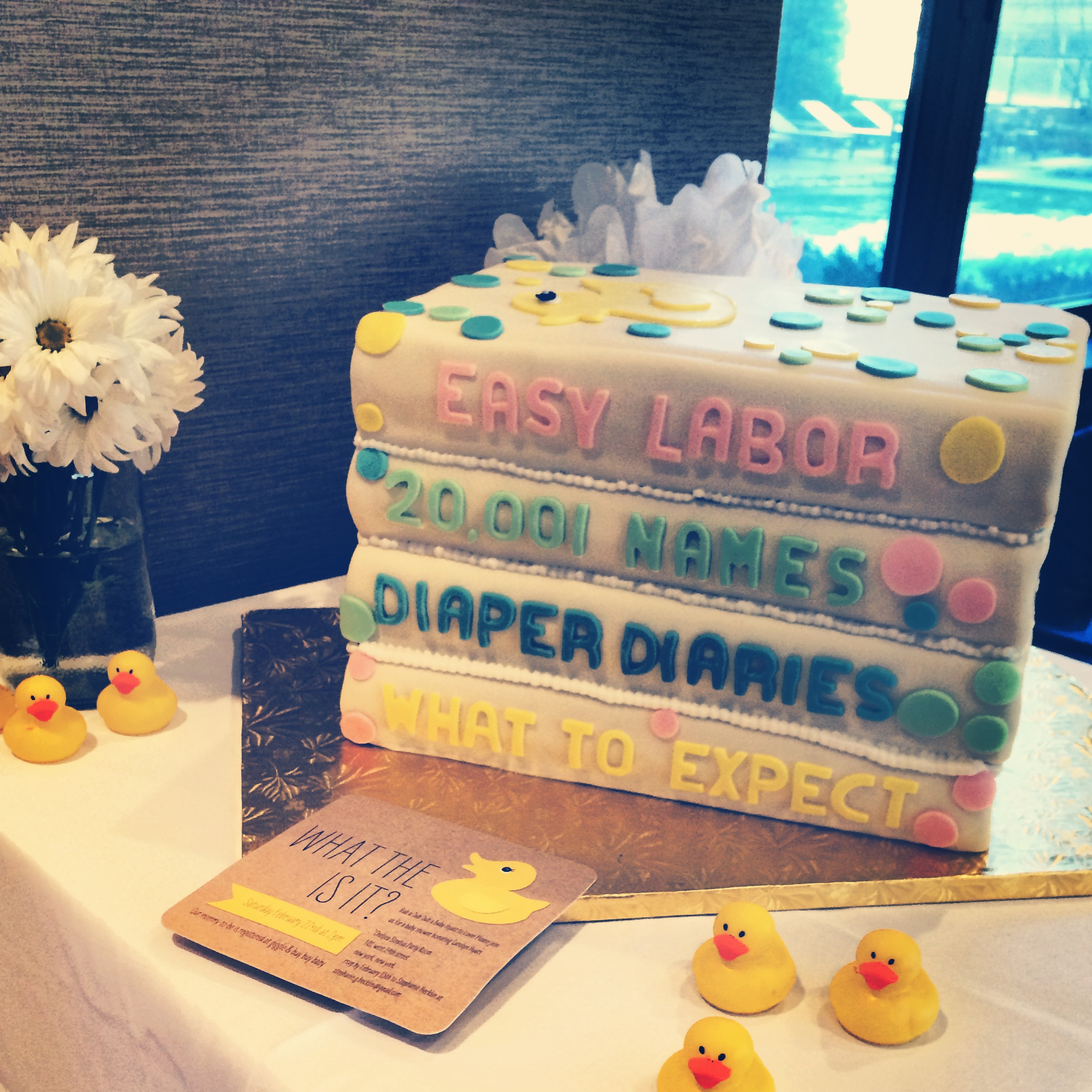 """What the  DUCK  is it?"" Baby Shower invites"" and a custom-made baby book cake from Bouchon Bakery"