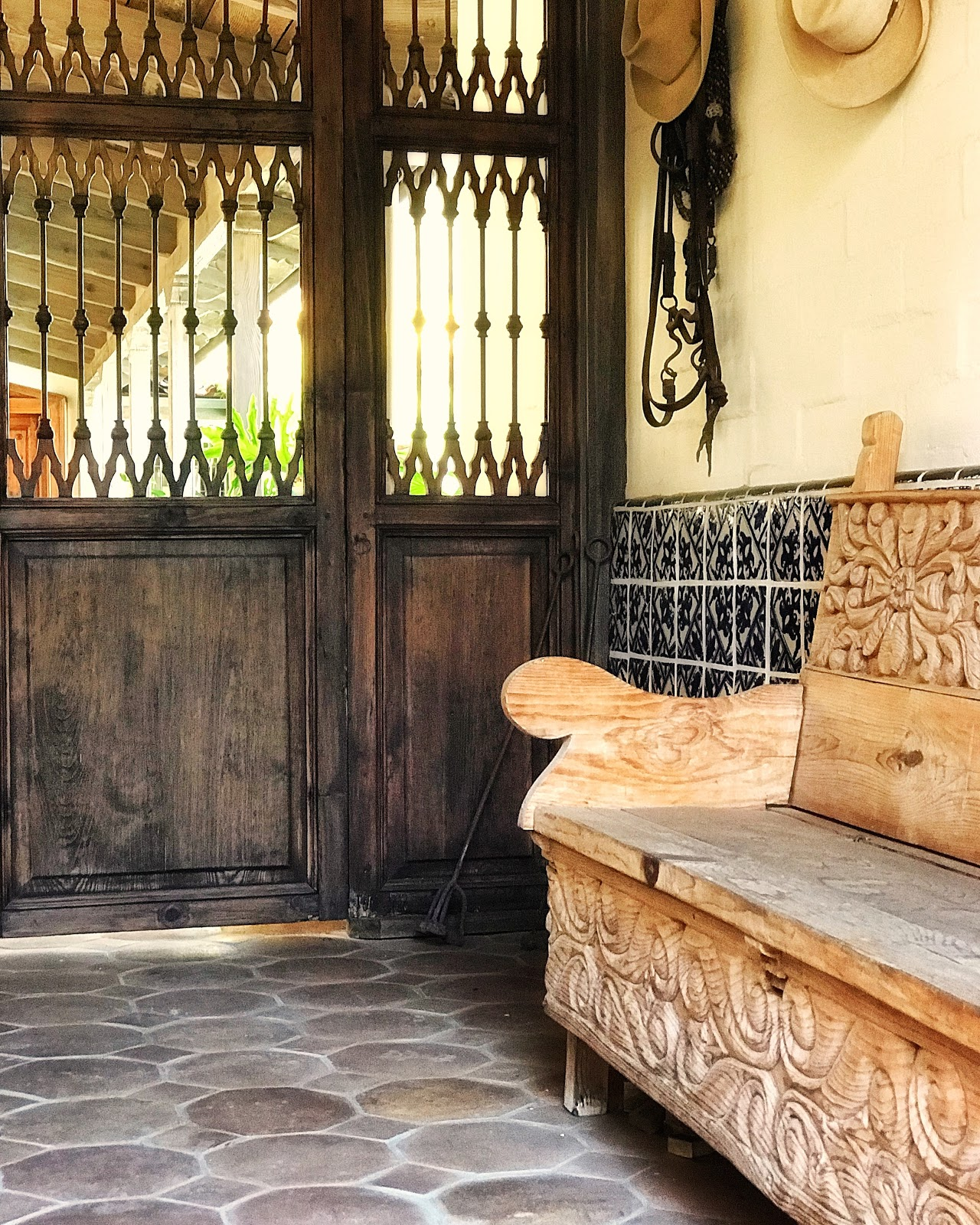 Pierced walnut entry doors that lead to the hacienda's inner courtyard