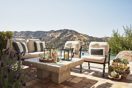 Potted vessels give this conversation area structure. Comfortable deep seating outfitted with today's amazing performance fabrics take the living room outside.