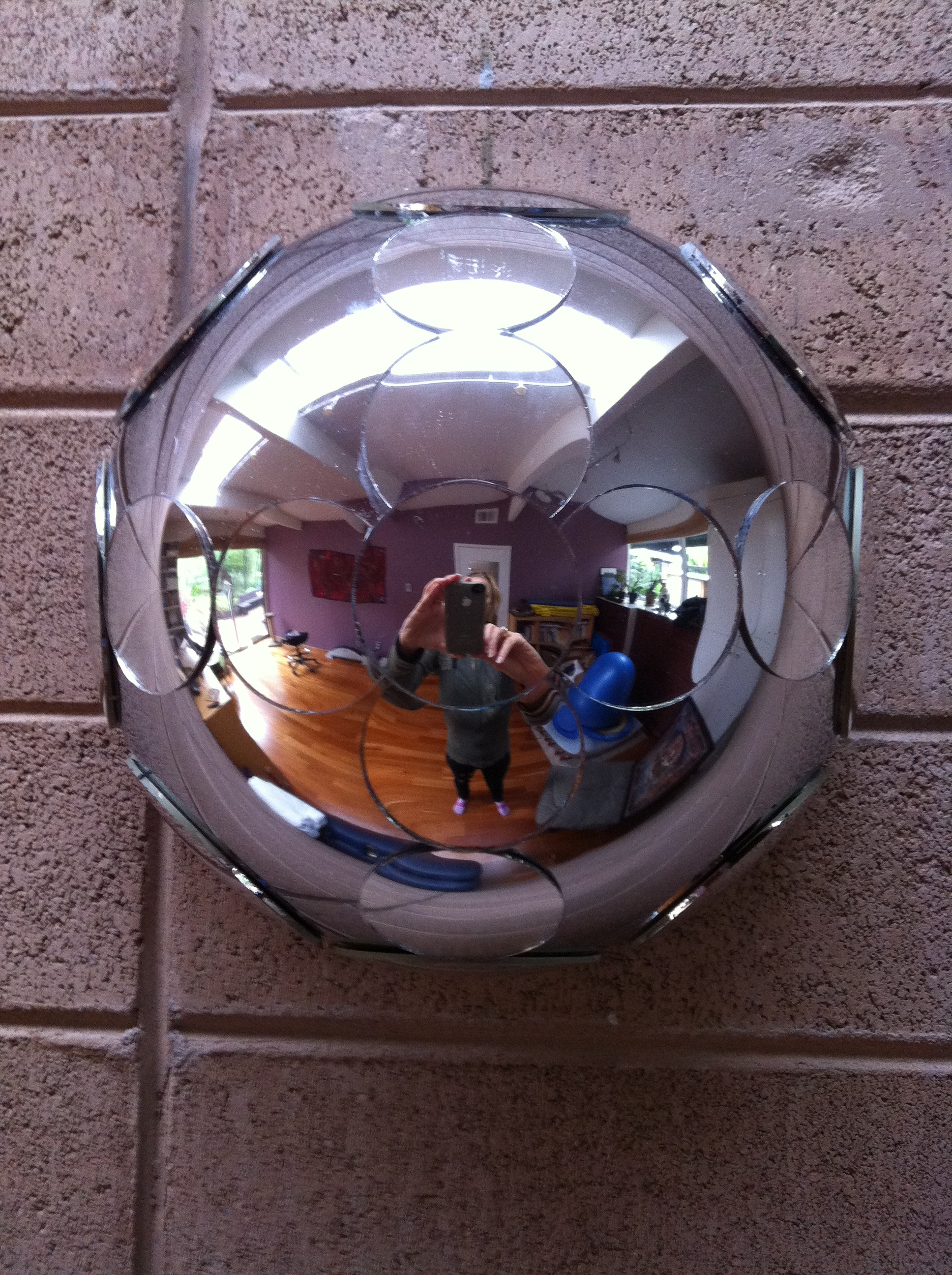 """Facet (Compound I/eye)   Stainless steel, convex mirror. 8.5"""" diameter x 5"""" depth  Created from Compound eye/I components.  Private Collection."""