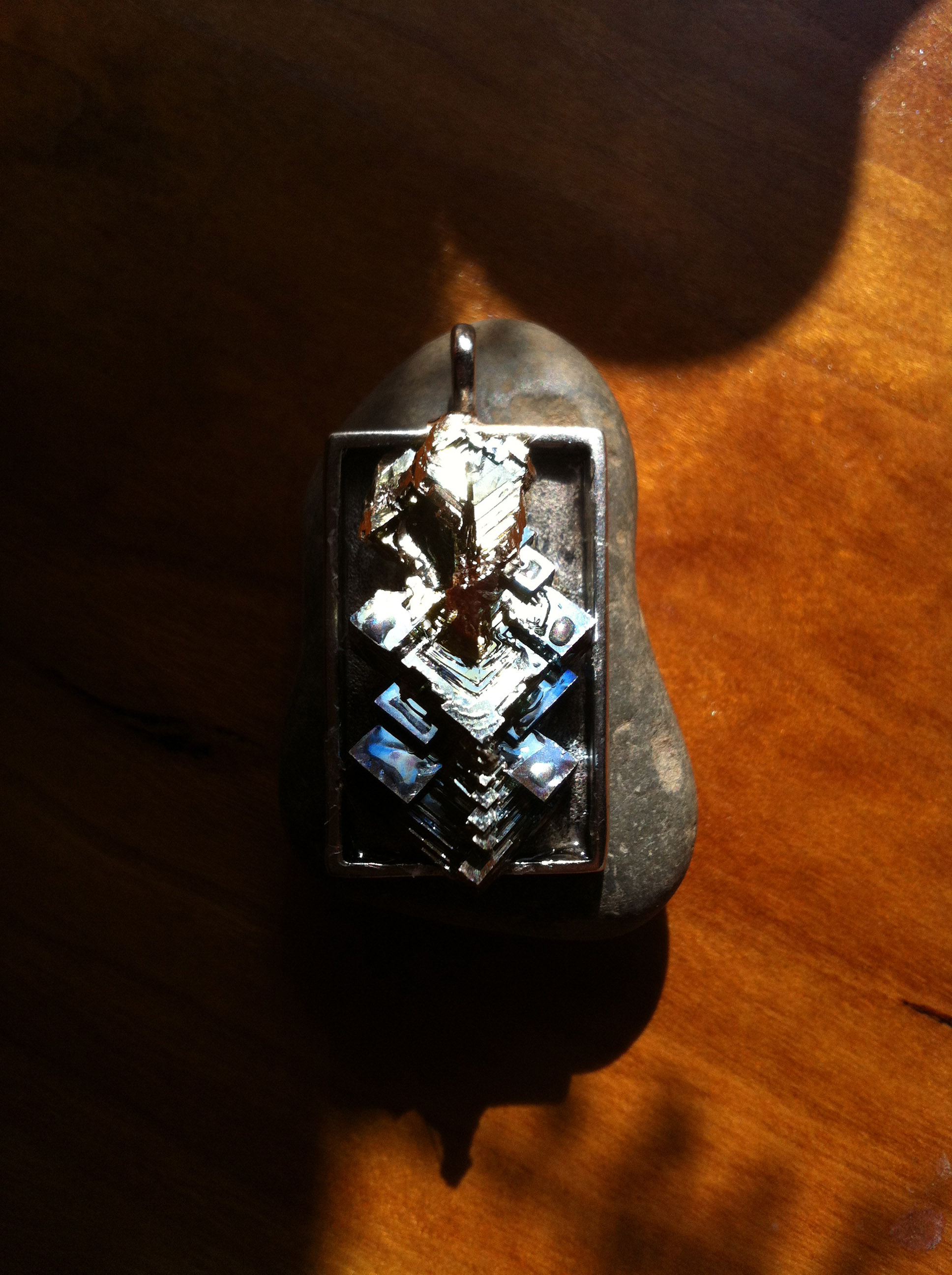 Ganesh   Bismuth metal crystal on steel pendant.   N/A