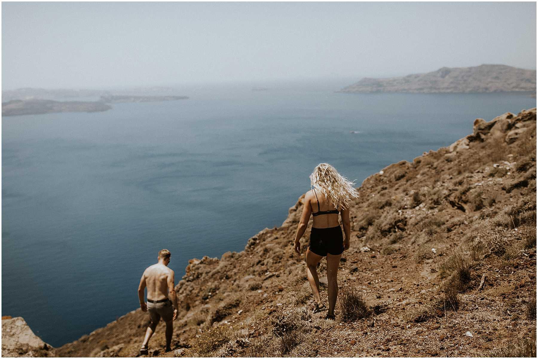 A couple hiking to Oia in Santorini Greece