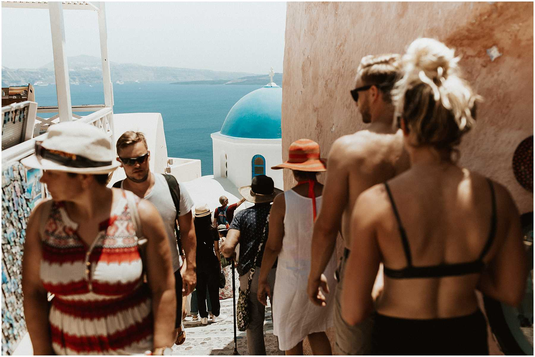 A couple walking the streets in Oia Santorini