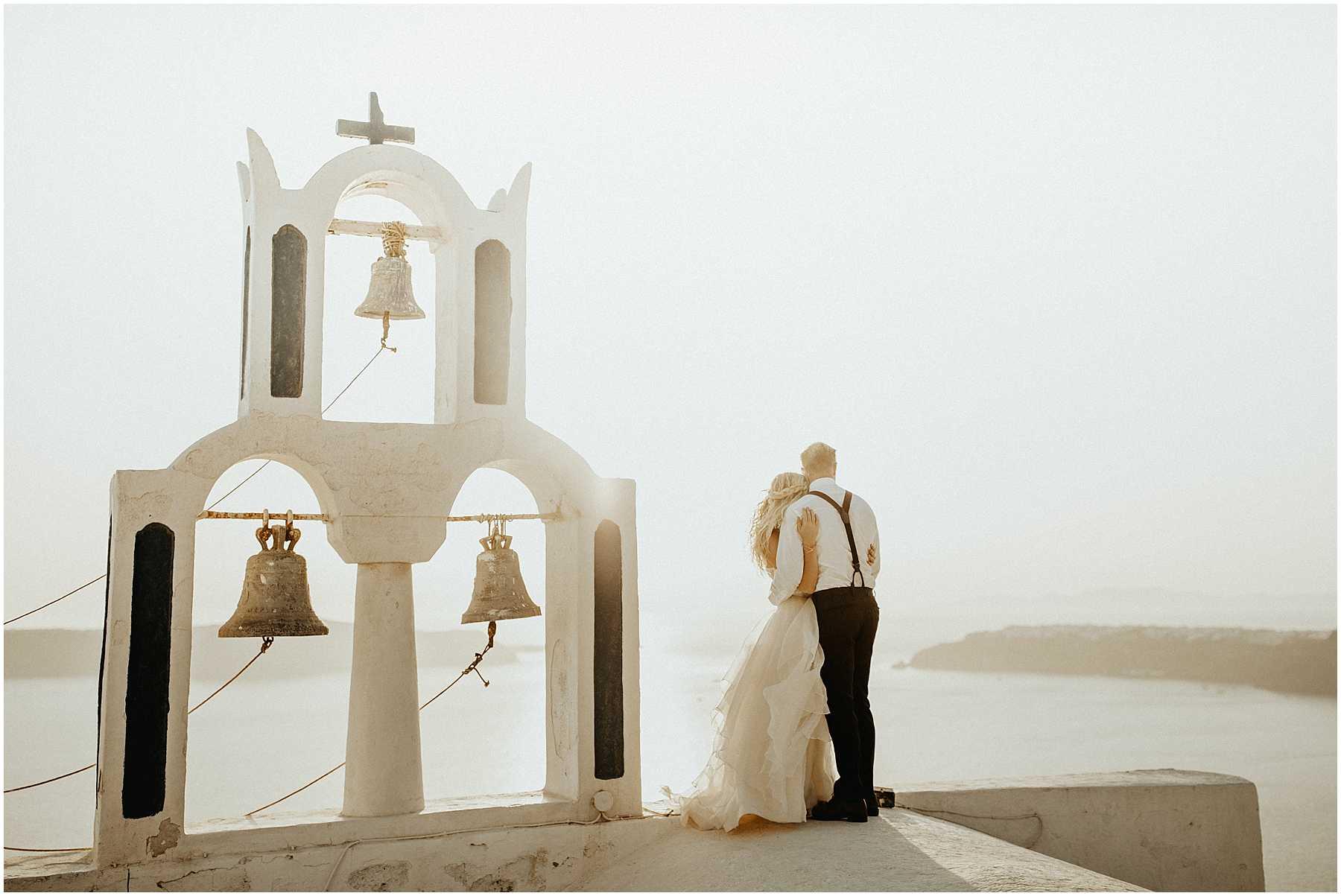 A couple elope on a church in Santorini Greece
