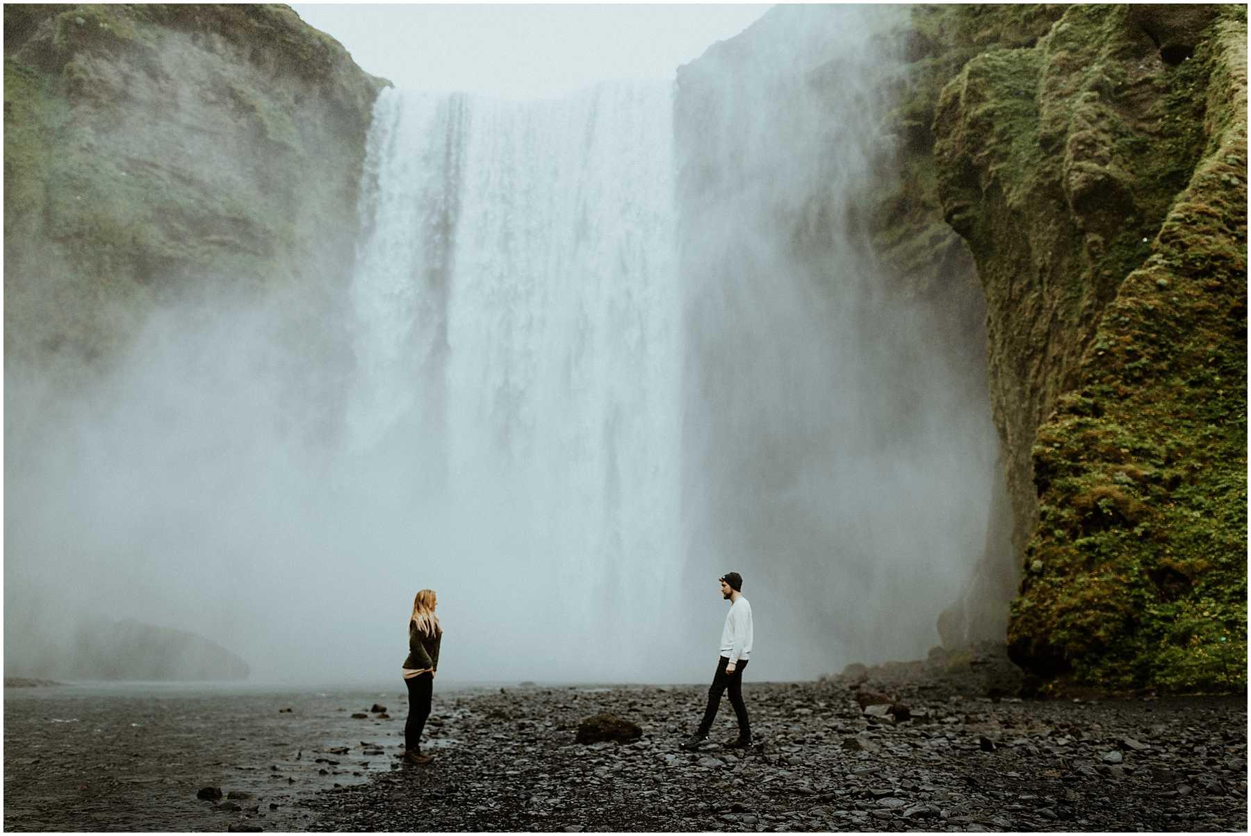 An adventurous engagement session Skogafoss Waterfall