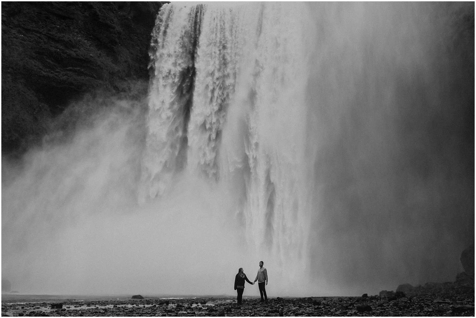 A couple at Skogafoss in Iceland