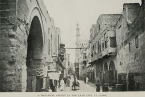 "Street in Cairo. CC BY-SA 2.5, Dudubot. Original source Sladen, Douglas. ""Oriental Cairo: the city of the 'Arabian Nights'"". J.B. Lippincott Company: Philadelphia and Hurst & Blackett, Ltd.: London, 1911. p 158."