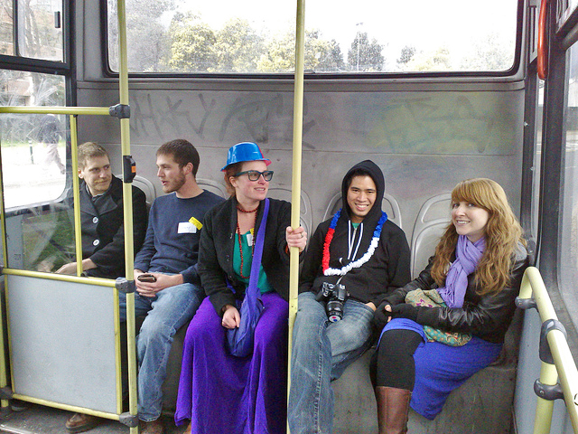 Super happy bus riders! by Chris Martin   (CC BY 2.0)