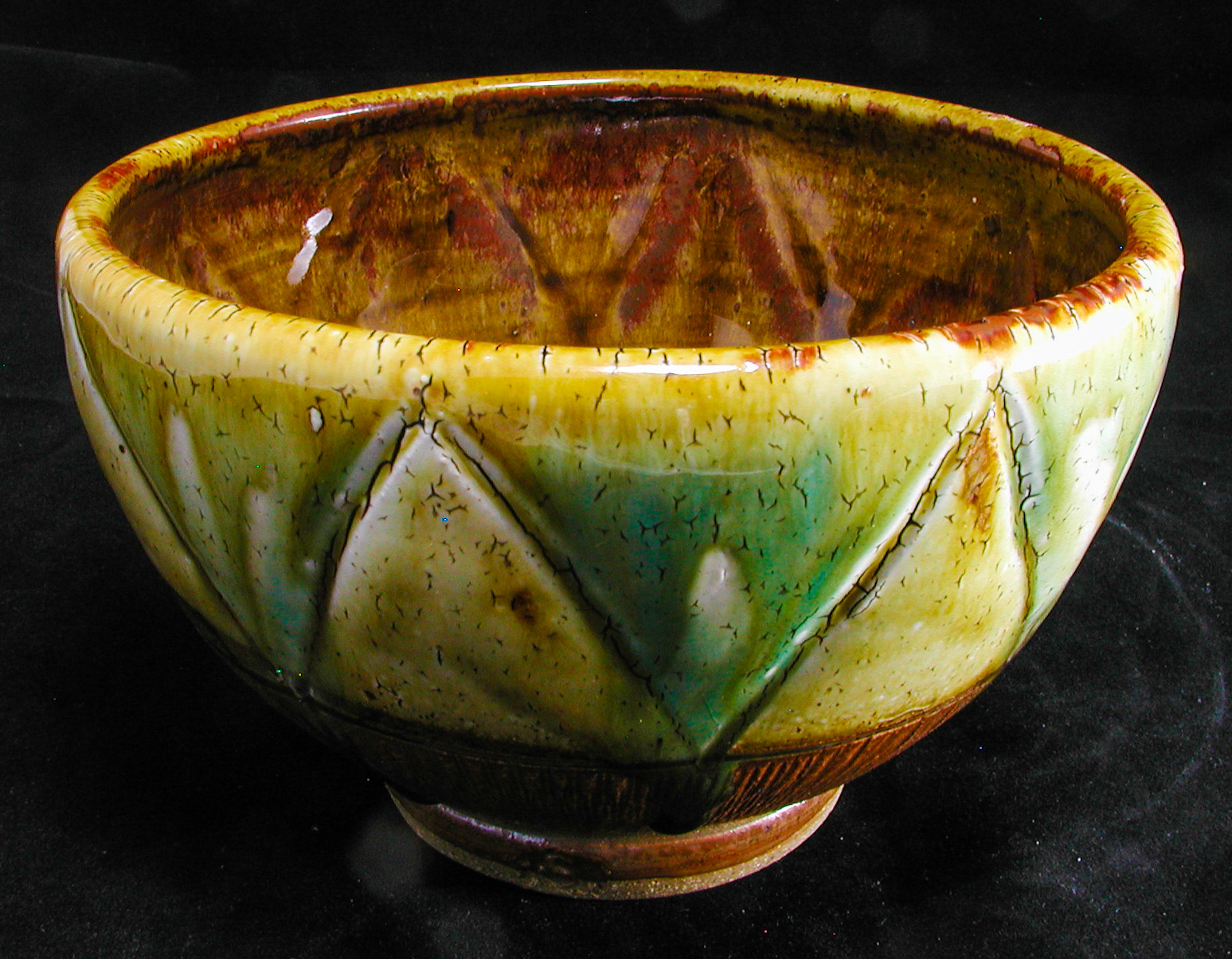 Stoneware bowl with triangle pattern and crackle slip, ash glazes