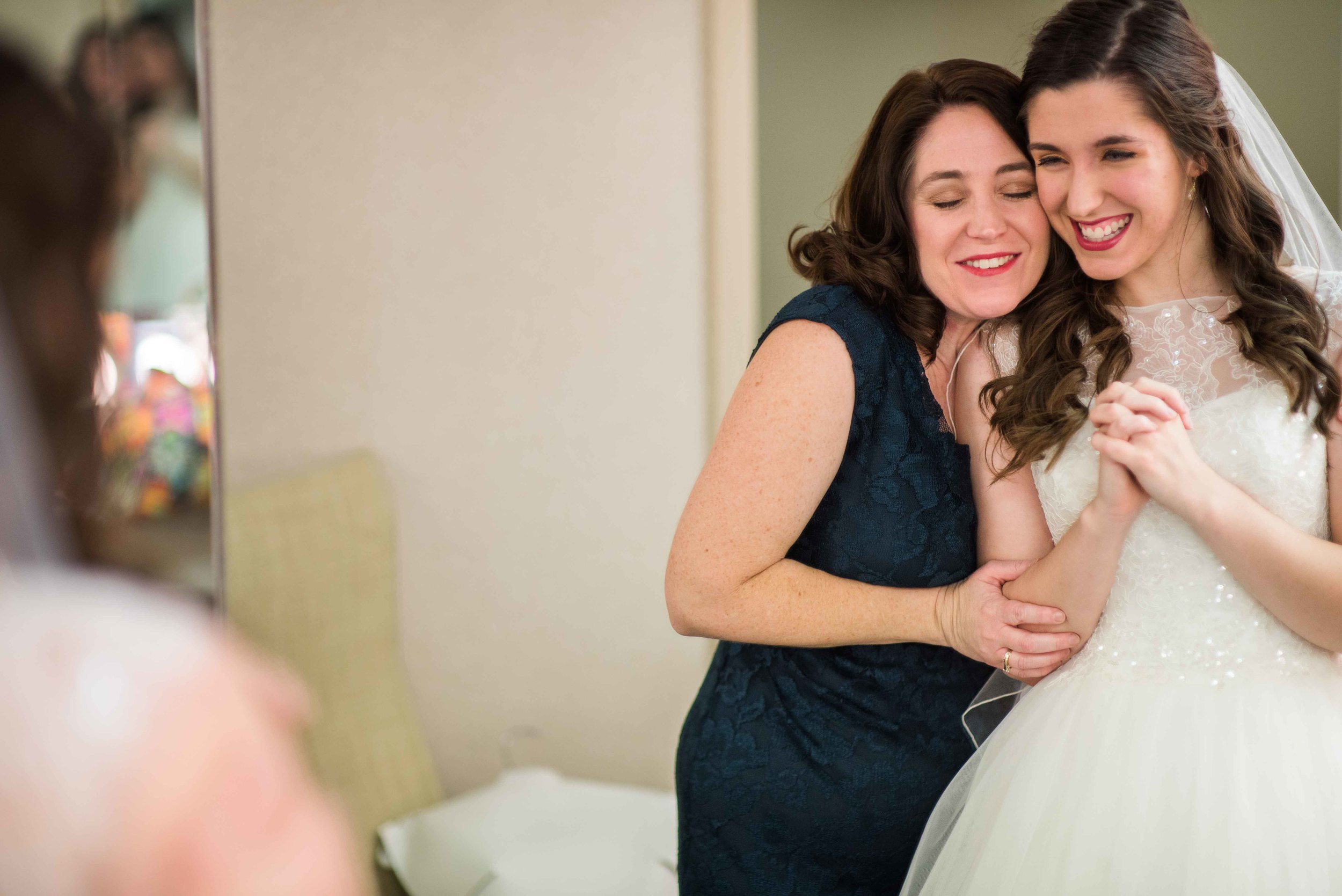 The Mother of the Bride seeing her Daughter in her wedding dress for the first time.
