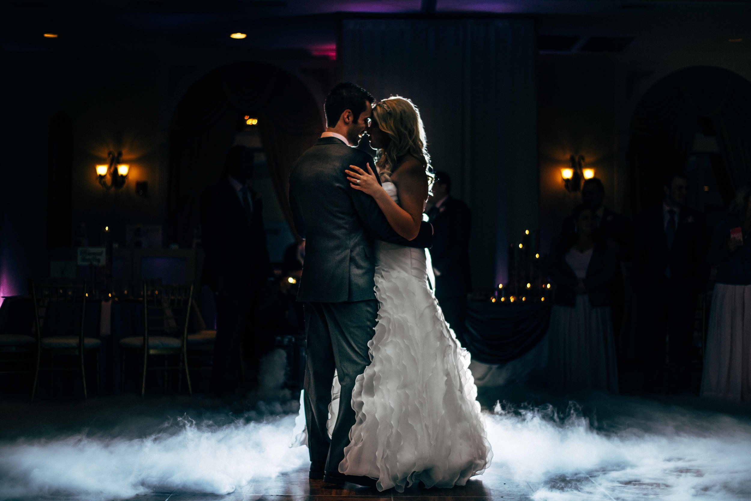DJ Eddie G  surprised the couple with a dry ice/fog machine mixture during their first dance.It looked like they were dancing on clouds!