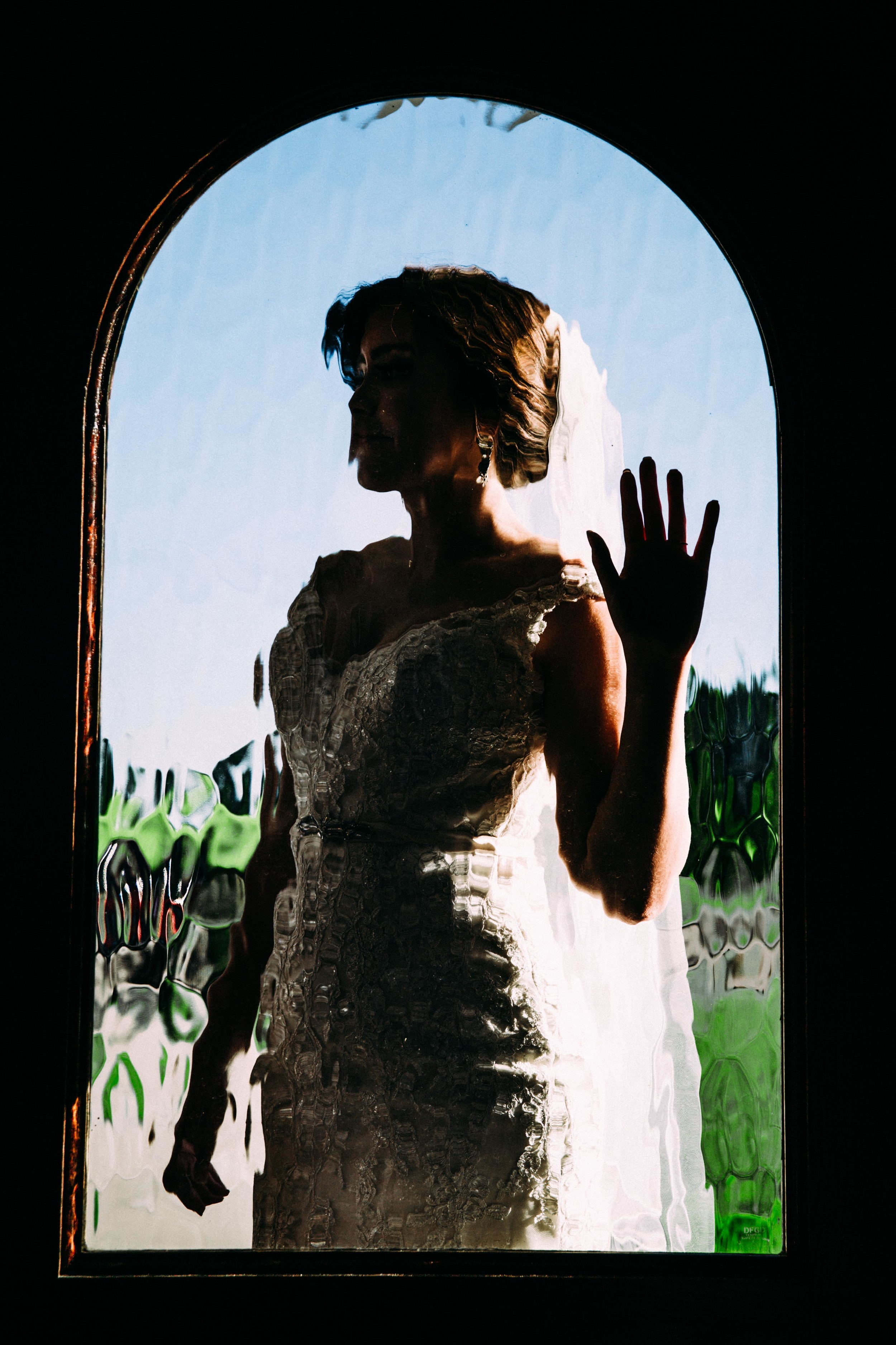 This shot turned into what is my new favorite bridal image of all time! I love silhouette images, and the textured from the glass door makes the photograph almost look like a painting!