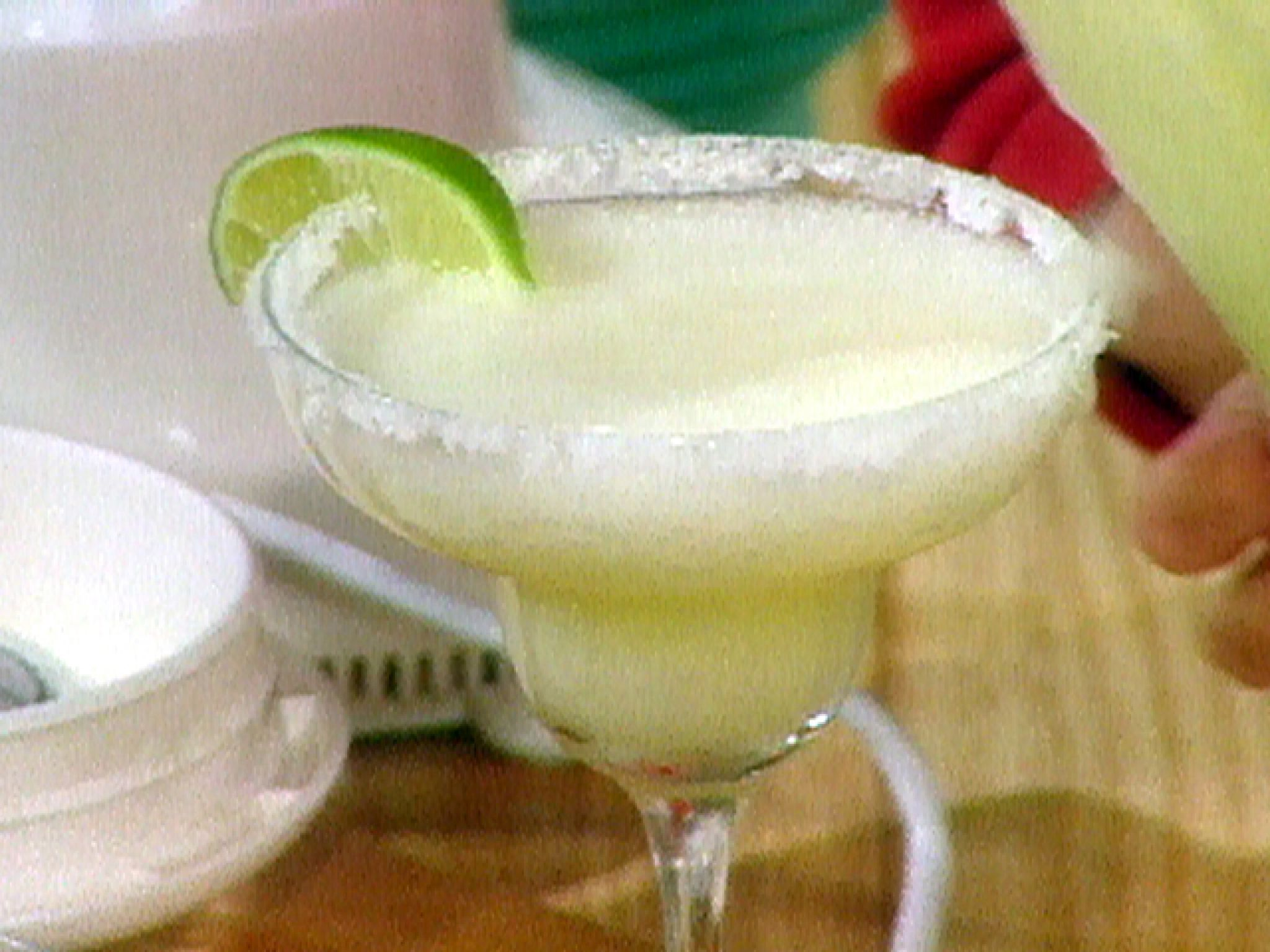 1 6-oz can frozen limeade (2/3 cup)  2/3 cup good quality tequila  1/3 cup triple sec  1/2 cup water  Ice  Combine limeade, tequila, triple sec and water in a blender. Fill to the brim with ice and blend until very smooth, about 1 minute. (Don't under blend, or mixture will be chunky rather than smooth). Serves 4.