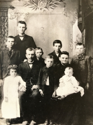 The Henry and Margaretha Buerer family. Forest standing between his mother and father.