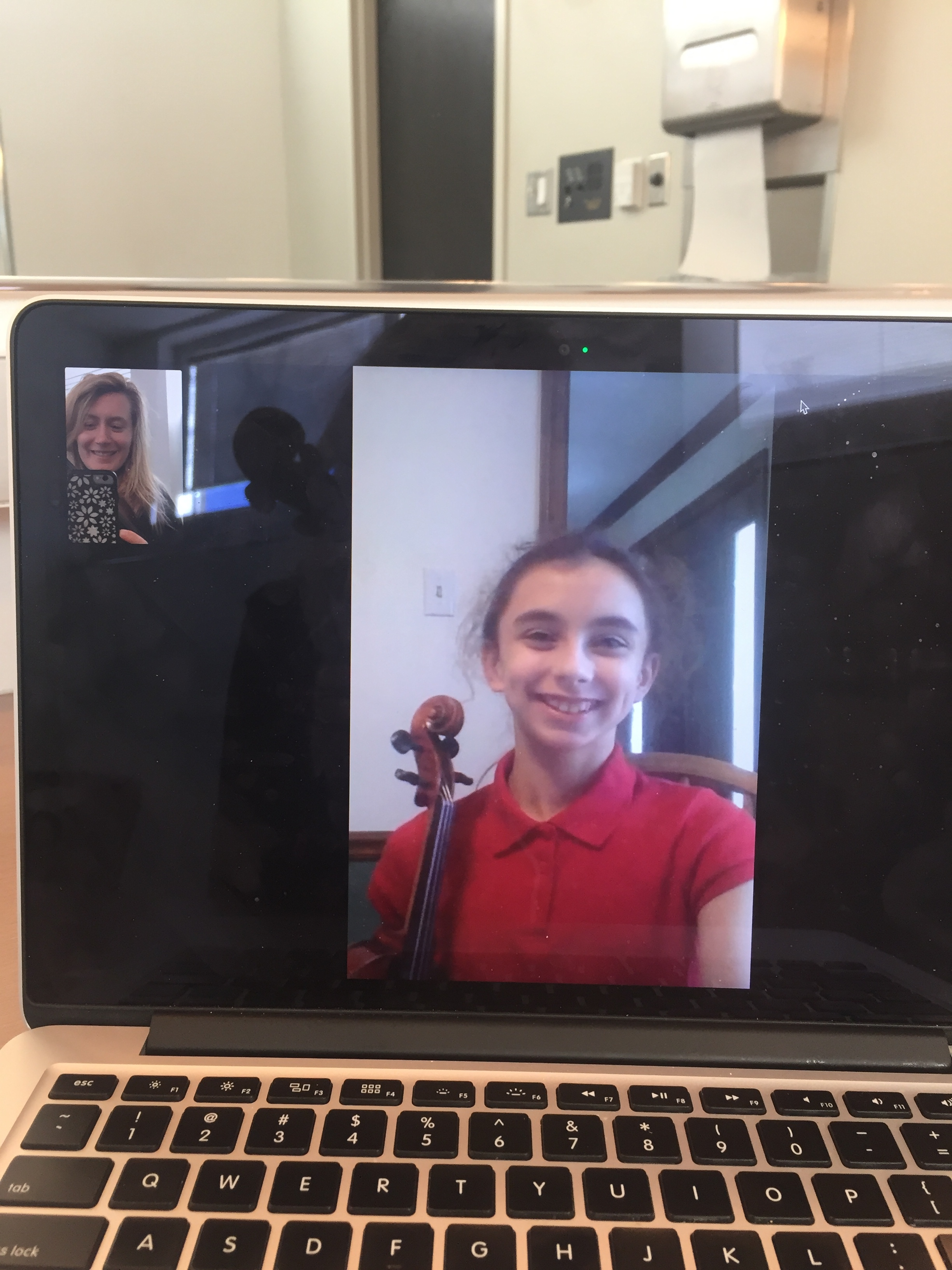 Myself on FaceTime with my young fiddle student, Brianna.