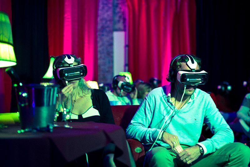 VR theaters and arcades may become more common as VR technology develops.  Photo Credit: Wikimedia Commons - Eliaboqueras