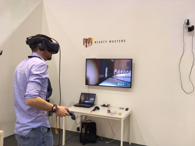 Conference attendee exploring the Kremer Collection VR museum