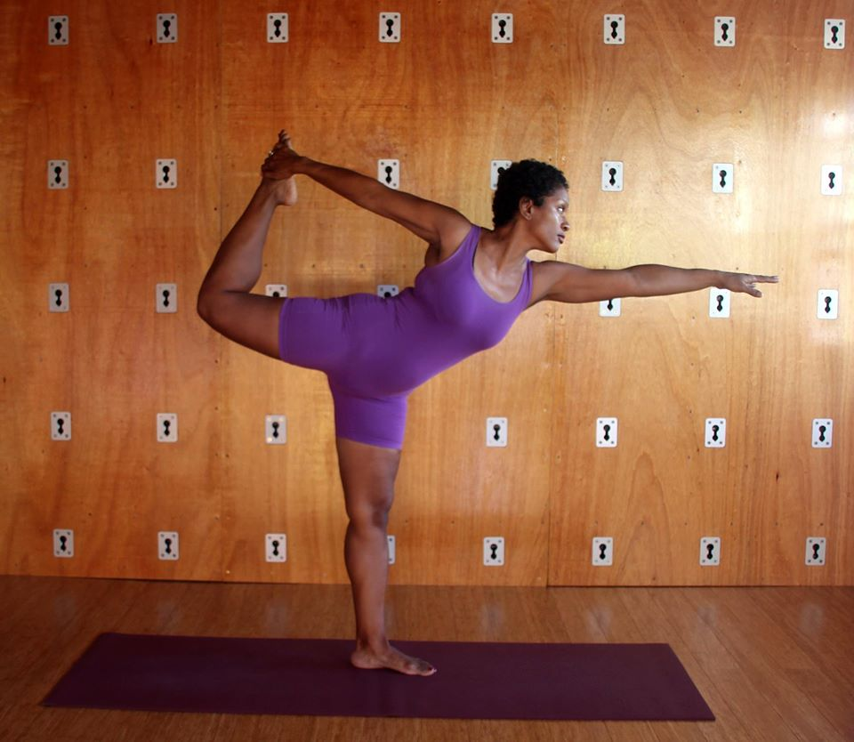 Demonstrating King Dancer's pose in Spice Harmony Yoga Studio, located on the third floor of Brooks-Smith Lowe Institute in Calivigny, St. George.