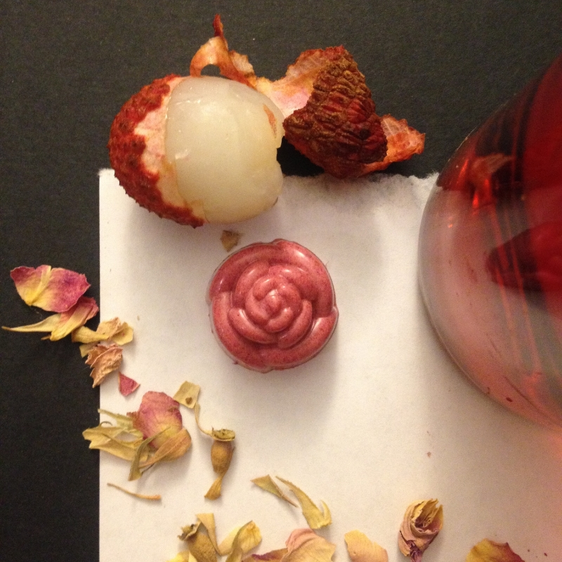 La Vie en Rosé: Dark chocolate ganache infused with lychee, a hint of rose tea, and dry rosé. The shell is tart raspberry and 31% white chocolate.