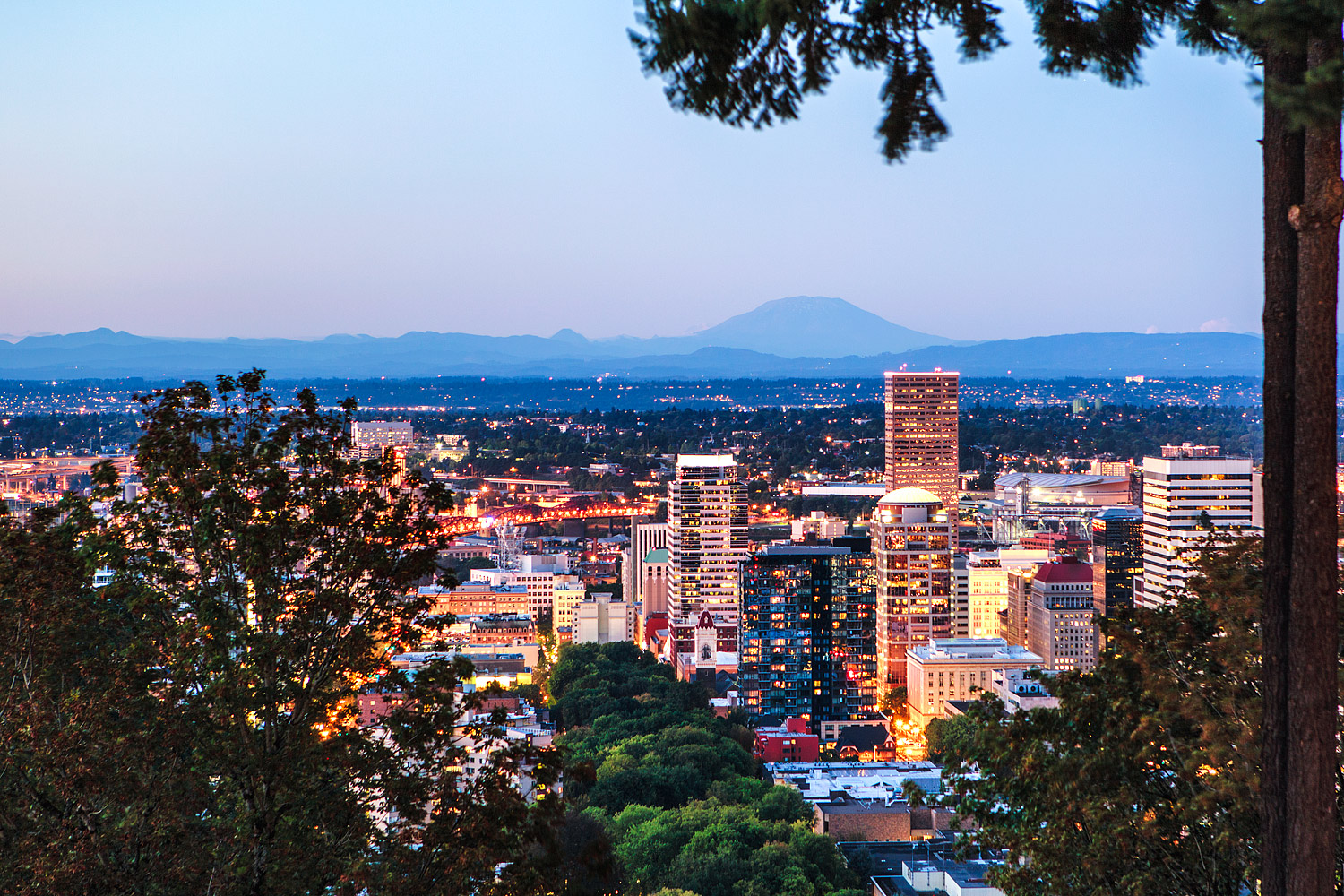 Mount St Helen's behind downtown Portland at sunset