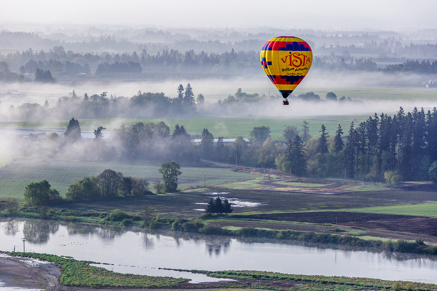 Hot Air Balloon above foggy St Paul, Oregon