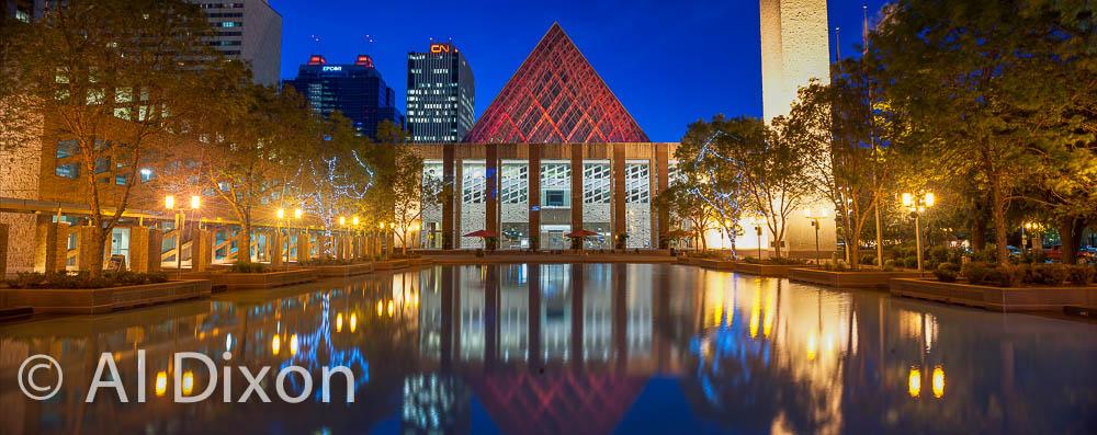 City Hall lit up at night.