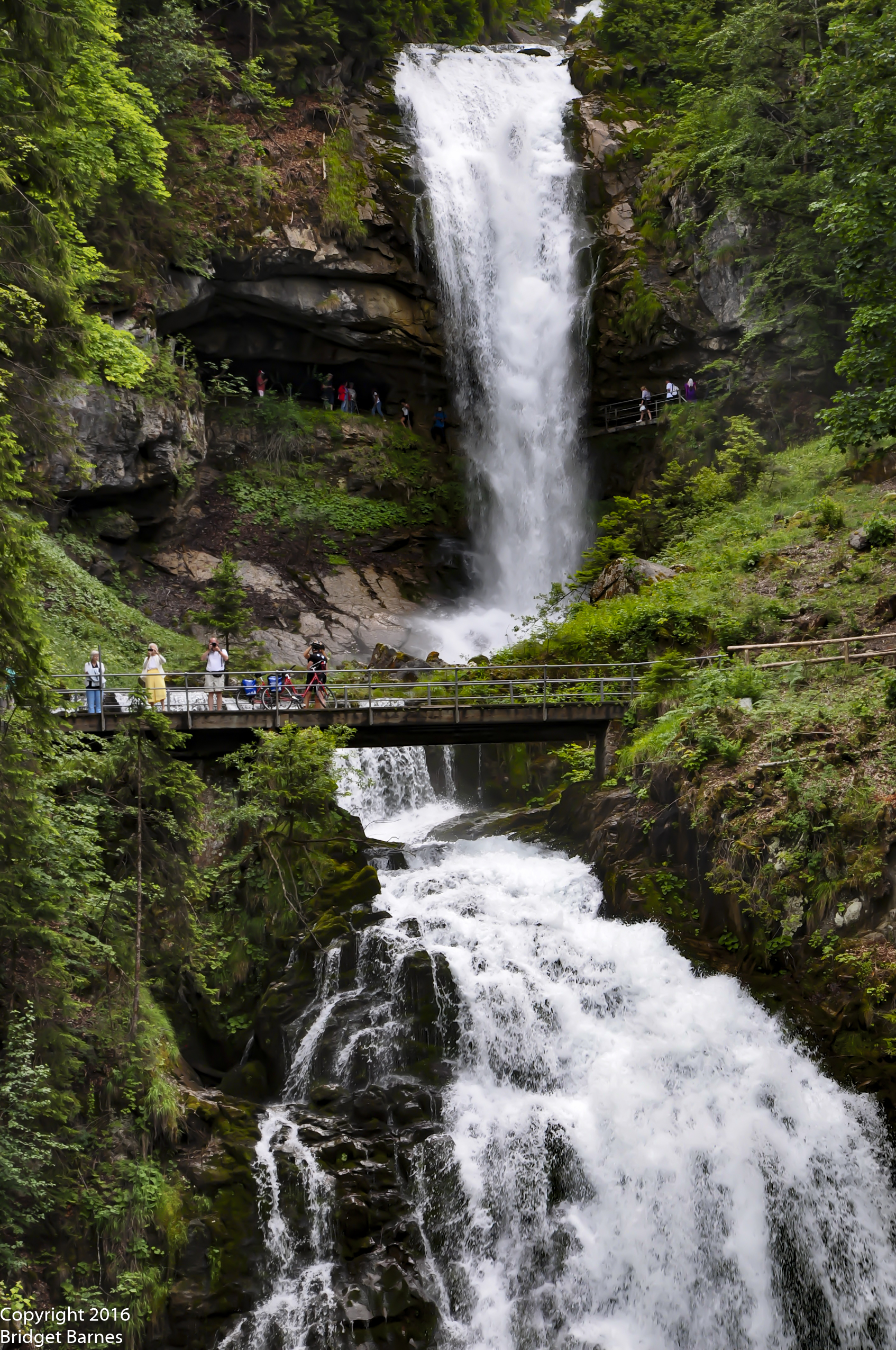 Visitors enjoying the expansive view of Giessbach Falls