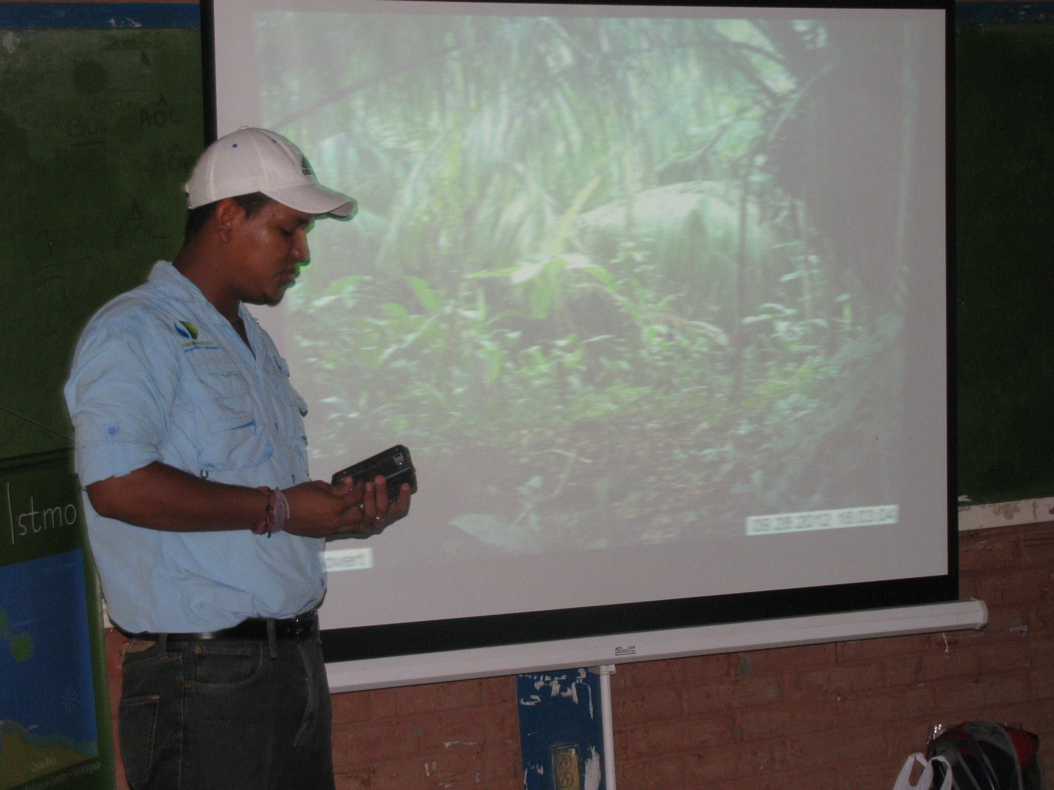 Marvin Chevez, Paso Pacifico Wildlife Technician, educating community members how camera traps work. He had family in nearly every community we visited, which helped break the ice.