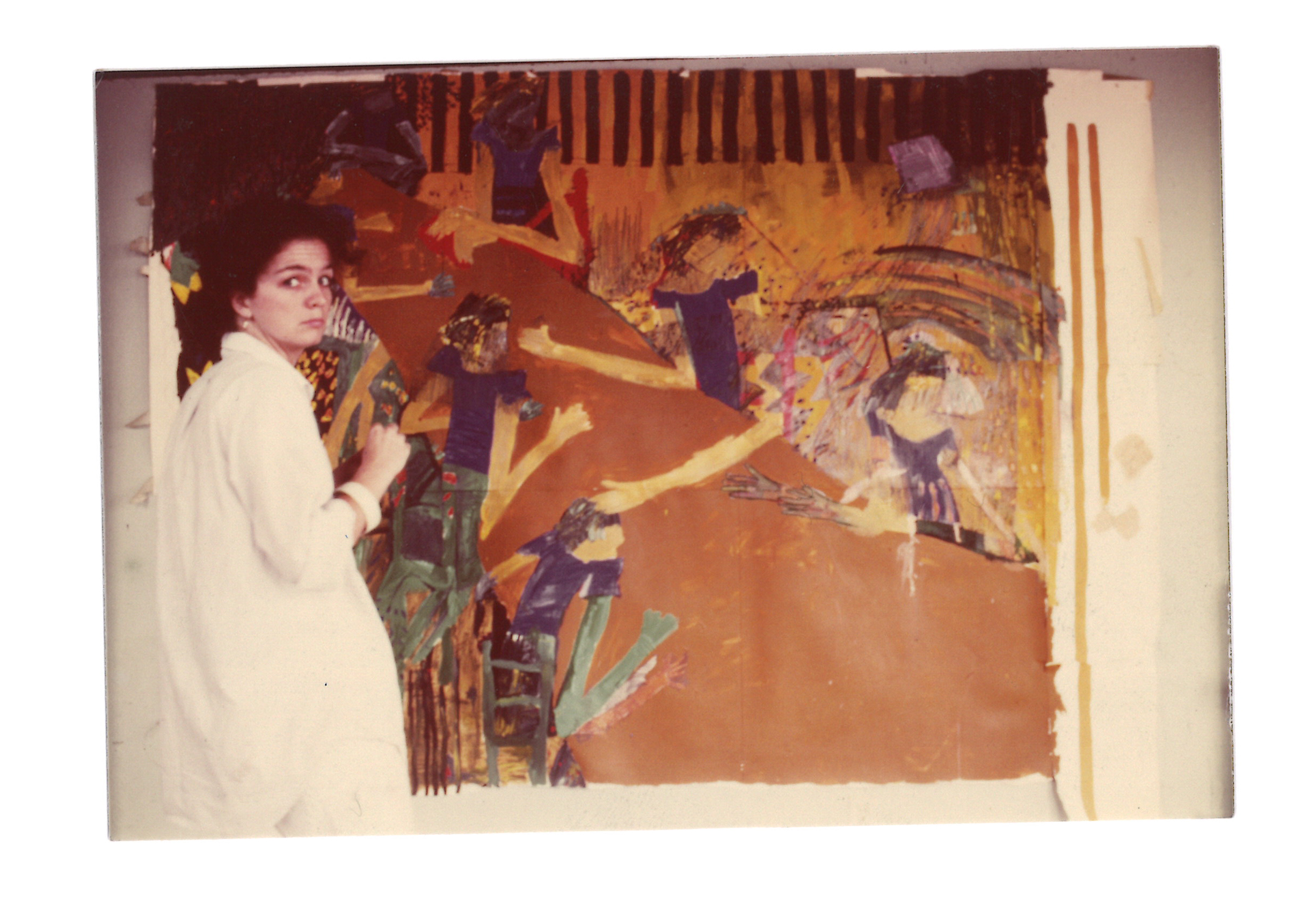 Kathy Ryan with one of her paintings after college.