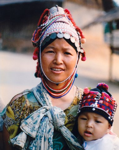 """Woman with child in Thailand."" by Peter van der Sluijs - Own work. Licensed under CC BY-SA 3.0 via Wikimedia Commons"