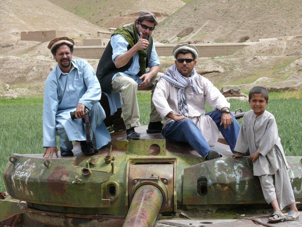 Scott Taylor (centre) with David Pugliese (left) and Sasha Uzinov on a old Soviet tank while unembedded in Afghanistan.