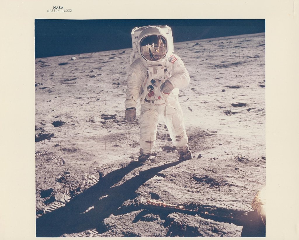 The iconic image of Buzz Aldrin's visor reflecting Neil Armstrong during their milestone walk as the first humans on the moon.