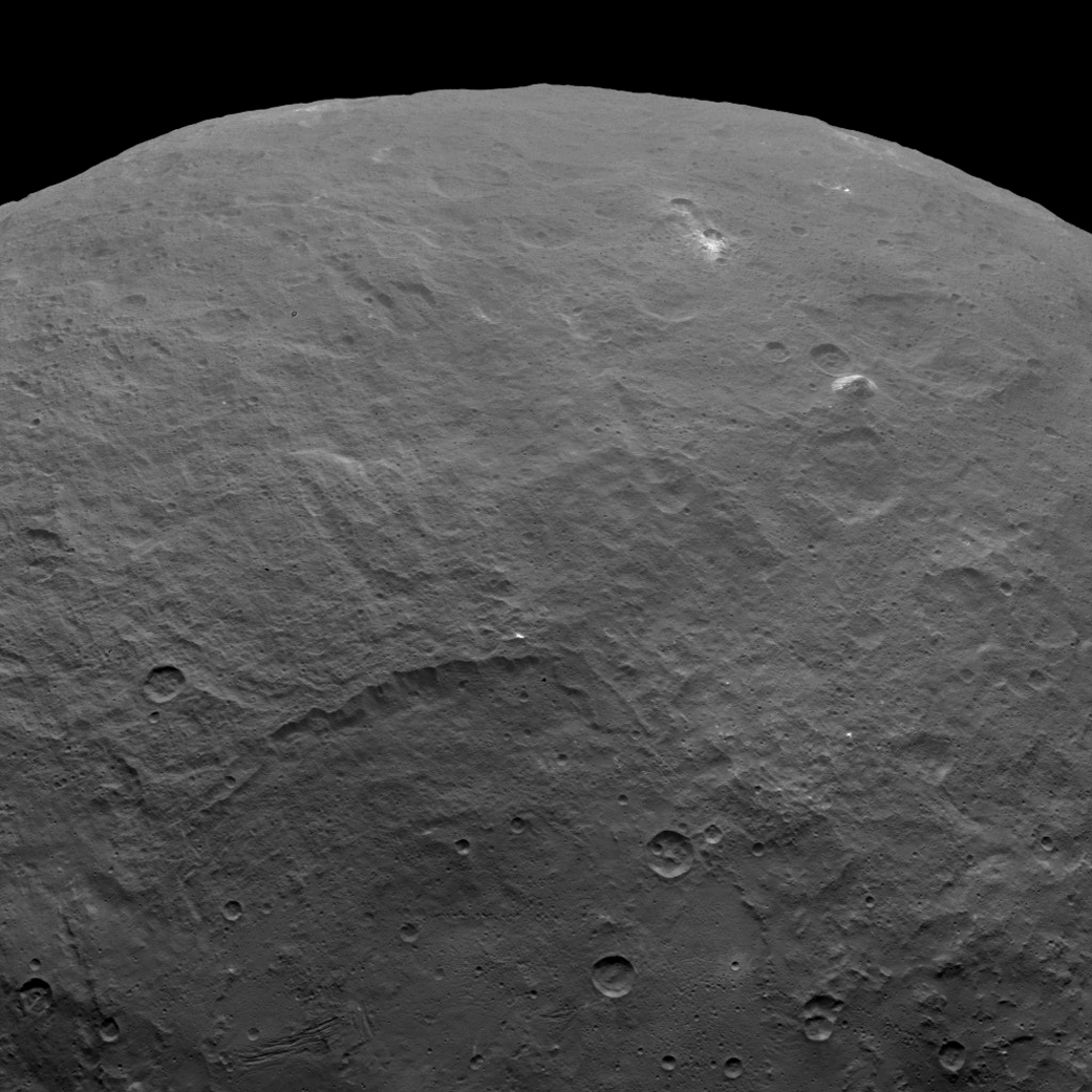 Equally mysterious is how the mountain, top right, formed on the relatively flat surface of Ceres. (NASA photo).