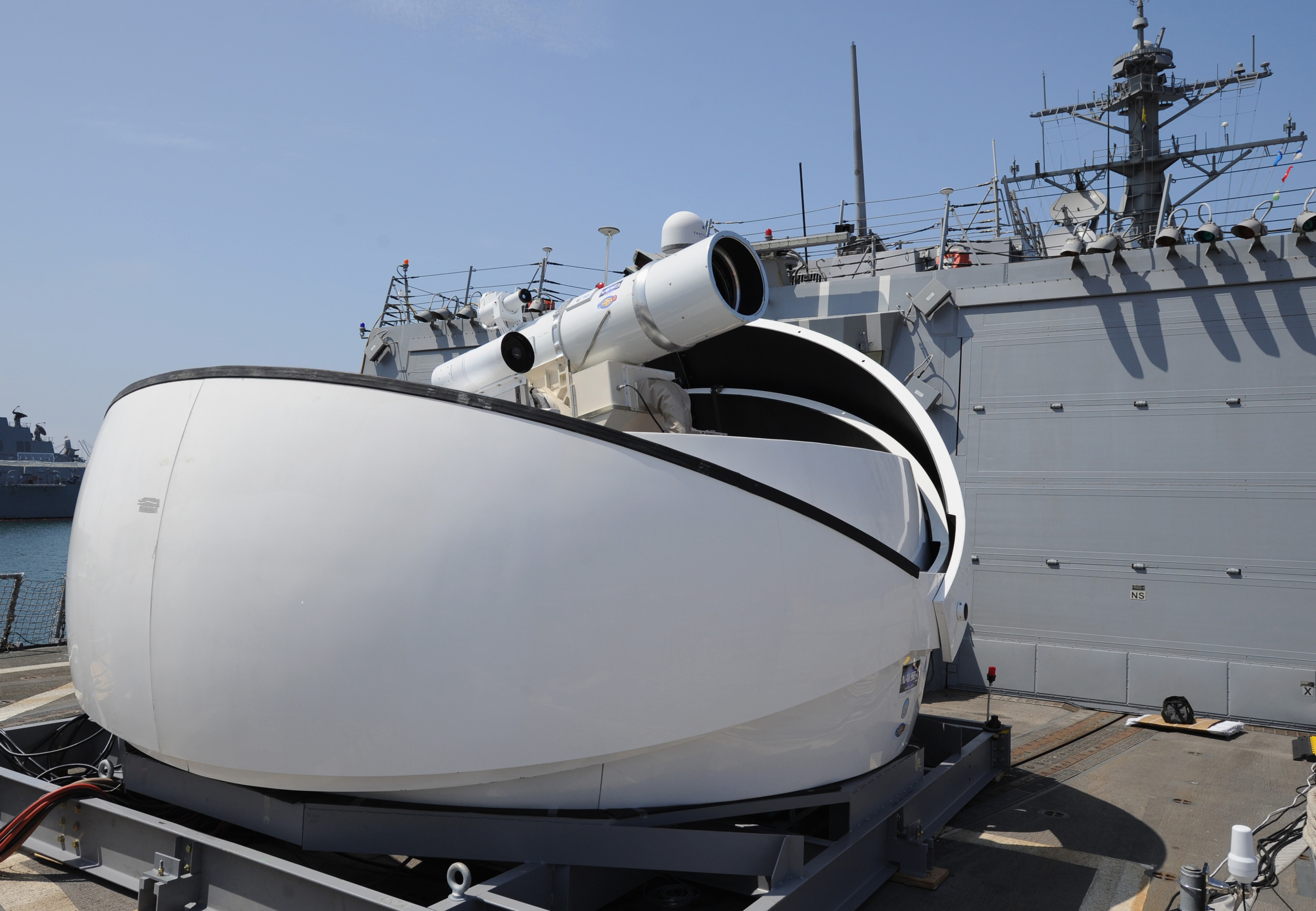 The Laser Weapon System (LaWS) temporarily installed aboard the destroyer USS Dewey, was developed by the Naval Sea Systems Command. It provides Navy ships a method to easily defeat small boat threats and aerial targets without using bullets. (U.S. Navy)