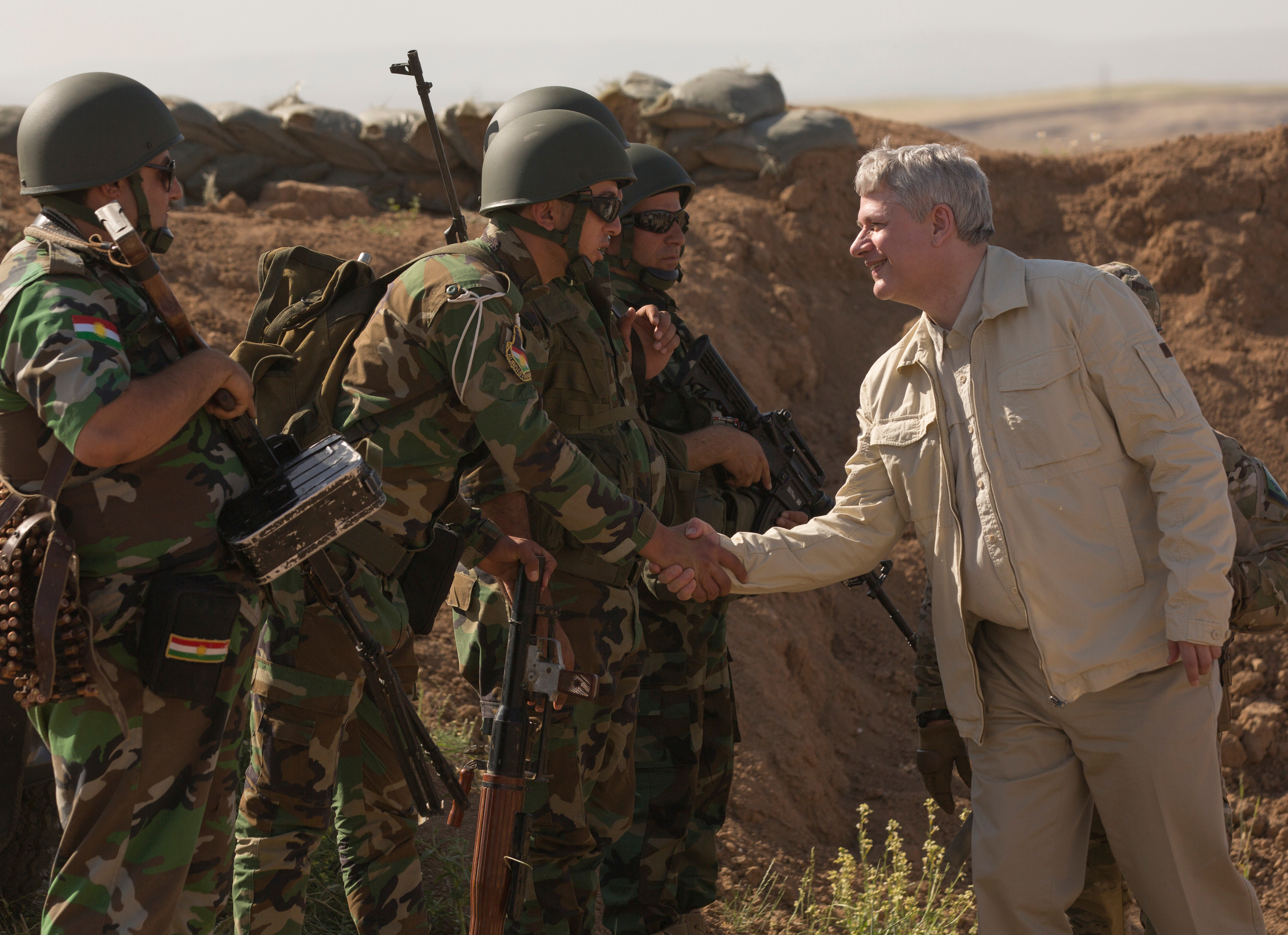 Prime Minister Stephen Harper greets Kurdish troops during a tour of allied operations in Iraq, May, 2015. For some reason the Kurdish Regional Government didn't make the invite list for a recent meeting of the anti-ISIS forces in Quebec City. (Jason Ransom, PMO)