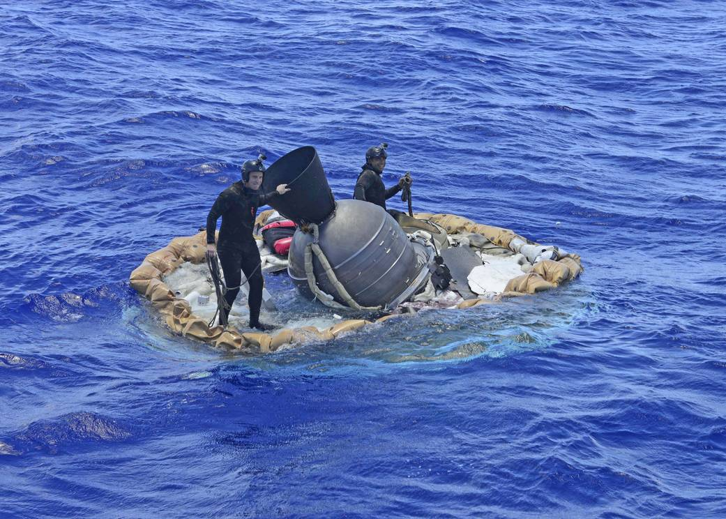 The lander, being retrieved from the Pacific Ocean. (NASA photo).