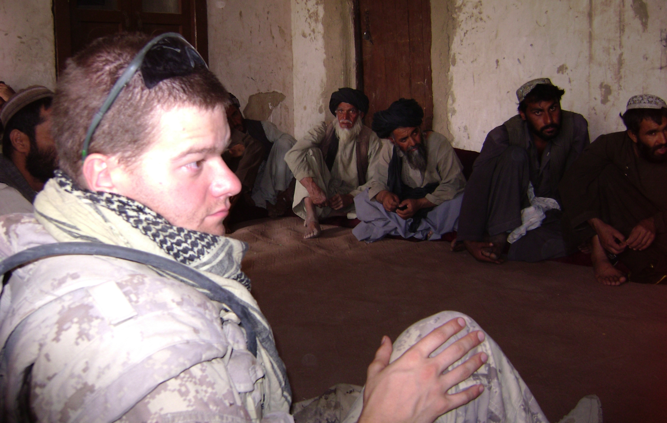 Captain Simon Mailloux discusses security and development concerns with the heads of villages surrounding the Canadian base at Sperwan Ghar in Afghanistan. The Canadians in Sperwan Ghar had been under sustained rocket and ambush attacks and winning the support of the population was key to their effort. Captain Mailloux was injured in an improvised explosive device (IED) in Afghanistan in 2007, which resulted in the loss of his left leg.