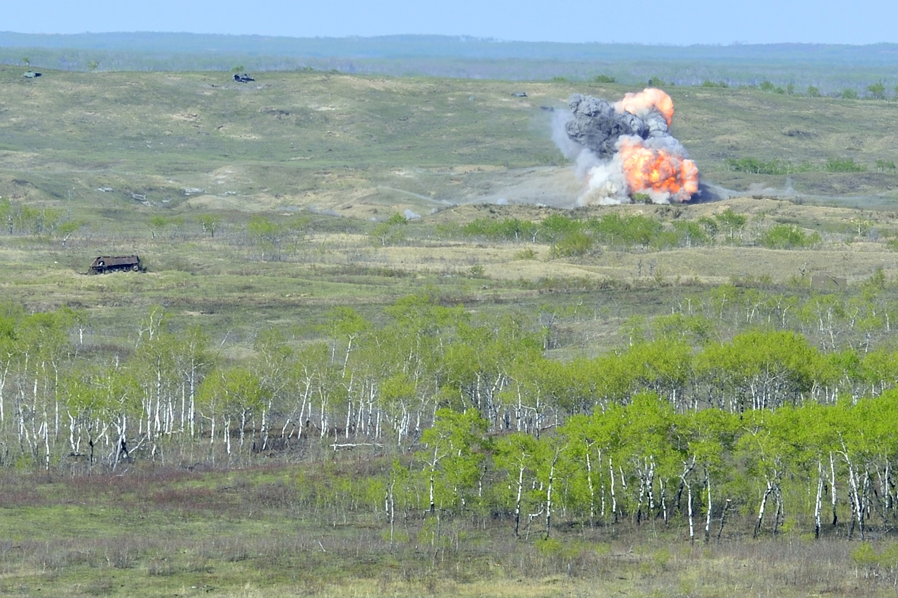 A CF-18 Hornet drops a 300lb bomb amid the rolling hills of CFB Wainwright's vast training area as part of EX MAPLE RESOLVE on May 6, 2015. The exercise, which simulates a large-scale conflict environment, is the largest annual Army exercise in Canada, drawing close to 5,200 Canadian soldiers and 700 members of the Royal Canadian Air Force, along with 700 American troops and 150 British soldiers. (Cpl True-Dee McCarthy, DND)