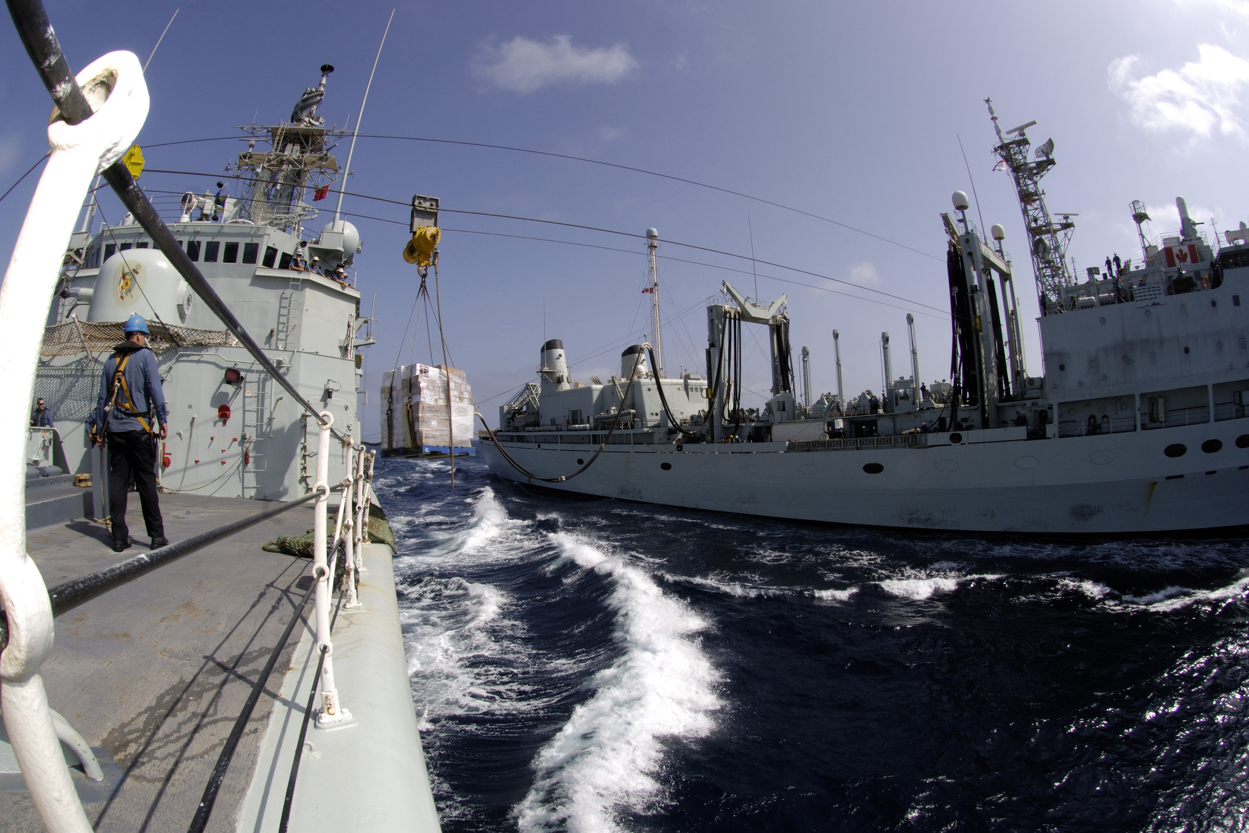HMCS Protecteur transfers a pallet loaded with food to HMCS Iroquois during a Replenishment At Sea (RAS) in the Arabian Sea, September 2008. Since 2014, the Royal Canadian Navy has been without a resupply capability after Protecteur caught fire at sea and HMCS Preserver - the RCN's other supply ship - was taken offline due to cracks in the hull. (DND)