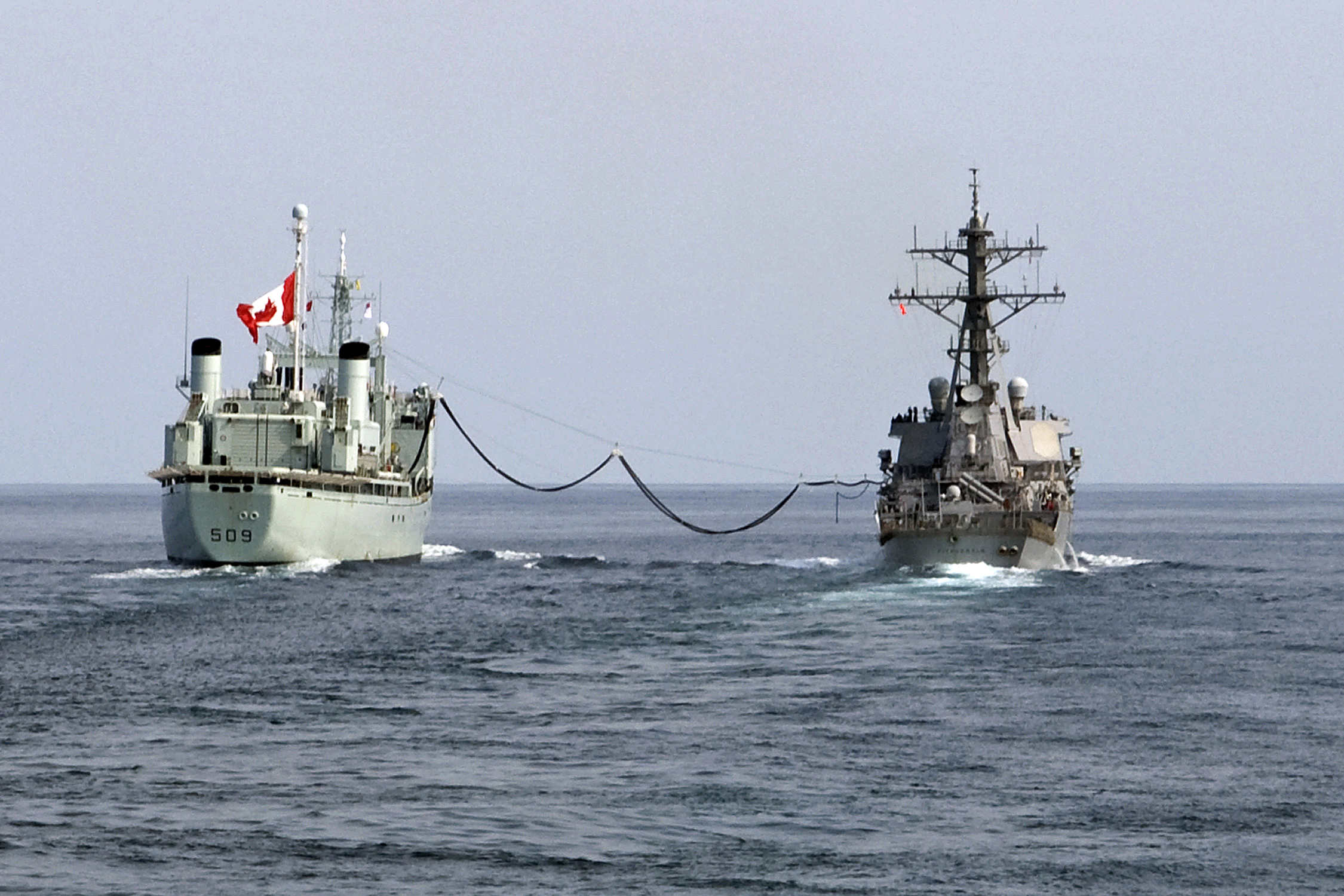 HMCS Protecteur transfers fuel to the USS Fitzgerald in 2009. Since the loss of Canada's resupply ships, the RCN has had to rely on allies to resupply at sea. (U.S. Navy)