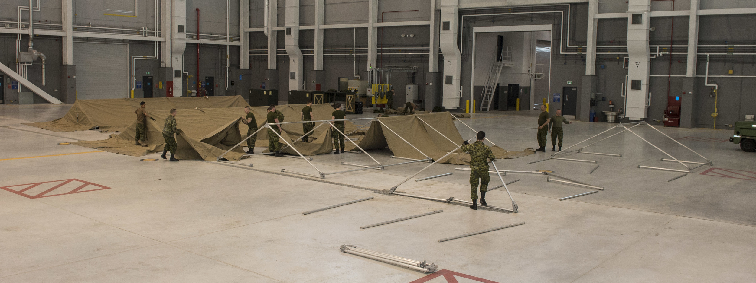 "Members of the Disaster Assistance Response Team (DART), check the serviceability of modular - or ""mod"" - tents at CFB Trenton during Exercise READY RENAISSANCE 2015 on February 23, 2015."