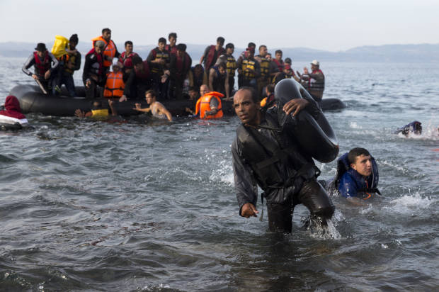 Refugees and migrants arriving from Turkey to Lesbos, Greece on September 9, 2015. (AP/Petros Giannakouris)