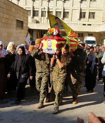 Images posted on Facebook show John Gallagher's coffin being carried through the streets of Syria wrapped in a Canadian flag and the flag of the Kurdish YPG guerillas.