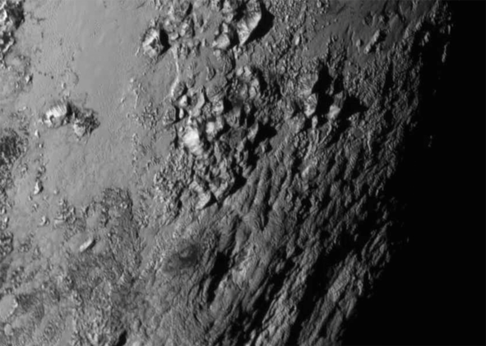 Close up photo of Pluto's surface captured by the New Horizons spacecraft. (nasa.gov)